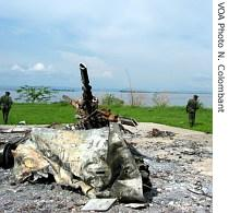 Bemba's guard stand next to downed helicopter