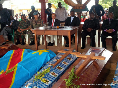 Officials attend a ceremony in honor of victims of the ADF rebels on 10.17.2014
