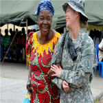 U.S. Army Maj. Angie Allmer assists a Congo resident to the medical waiting area in Kinshasa, Democratic Republic of the Congo, Sept. 14, 2010.