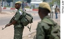 Regular Congolese army soldiers hold a position on a street corner in Kinshasa, 22 Mar 2007