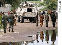 Soldiers and local people gather near a United Nations armoured vehicle in Kinshasa, Nov. 13, 2006