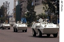UN troops in armored vehicles drive through the streets of Kinshasa, Congo