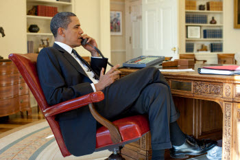 U.S. President Barack Obama on the phone in the White House Oval Office in 2010