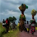 Congolese civilians fleeing Laurent Nkunda's rebels