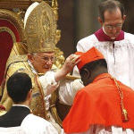 Newly-elevated Cardinal Laurent Monsengwo Pasinya, of the Democratic Republic of Congo, receives the red three-cornered biretta hat from the Pope during a consistory inside St. Peter's Basilica, at the Vatican, 20 Nov 2010
