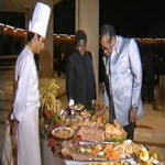 Mobutu dining with family and friends